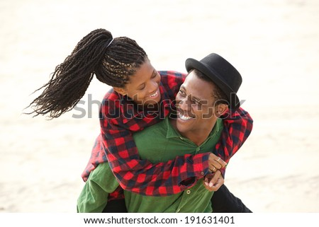Portrait of a happy couple smiling together outdoors - stock photo