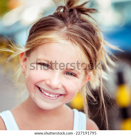 Portrait of a happy cute liitle girl close-up - stock photo