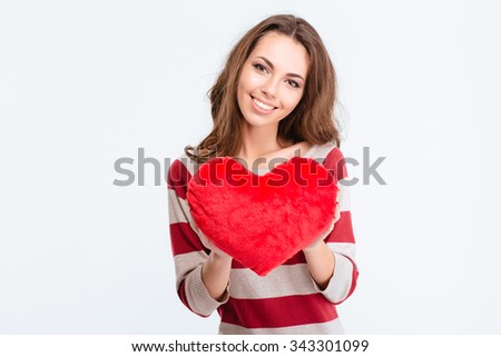 Portrait of a happy cute woman holding red heart isolated on a white background
