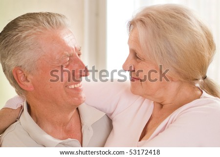 portrait of a happy elderly couple on a light