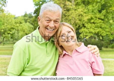 Portrait of a happy elderly couple outdoors.