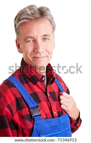 Portrait of a happy elderly DIY worker - stock photo