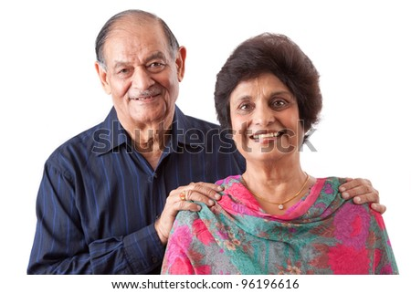 Portrait of a happy elderly East Indian couple - stock photo