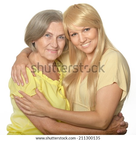 Portrait of a happy , embracing mom and daughter - stock photo