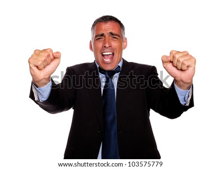 Portrait of a happy executive on black suit screaming and celebrating on isolated background