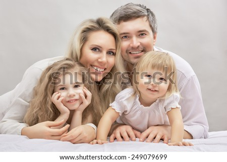 Portrait of a happy family - stock photo