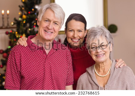 Portrait of a happy family at christmas at home in the living room - stock photo