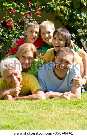 portrait of a happy family at nature - stock photo