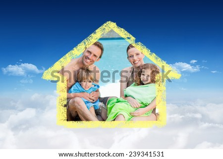 Portrait of a happy family beside the swimming pool against bright blue sky over clouds - stock photo