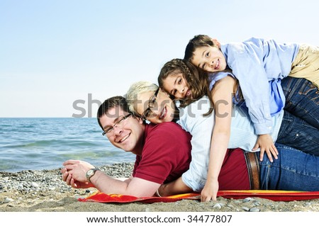 Portrait of a happy family having fun on a beach