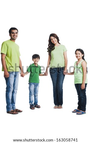 Portrait of a happy family holding hands - stock photo