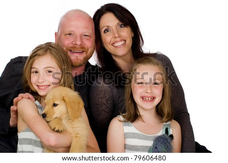 Portrait of a happy family in front of an isolated white background