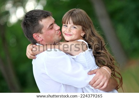portrait of a happy family in summer nature - stock photo