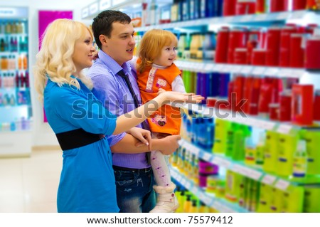 Portrait of a happy family in the store - stock photo