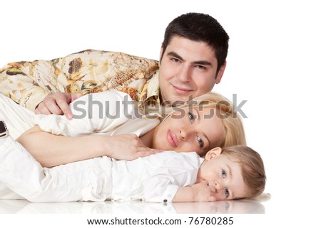 Portrait of a happy family lying on the floor isolated on white background - stock photo