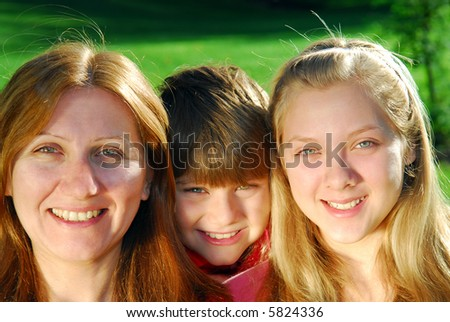 Portrait of a happy family - mother with her children - stock photo