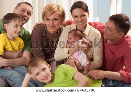 portrait of a happy family of seven people
