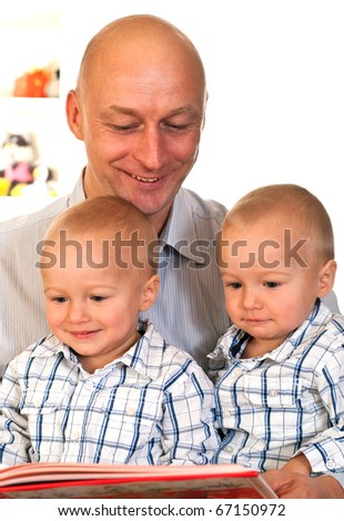 portrait of a happy family of three on a light background - stock photo