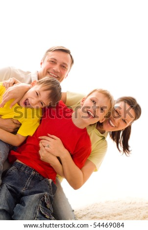 portrait of a happy family on a light - stock photo
