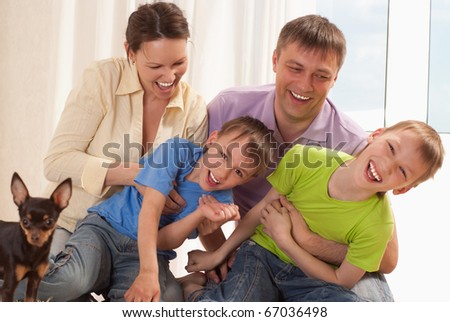 portrait of a happy family on a white background - stock photo