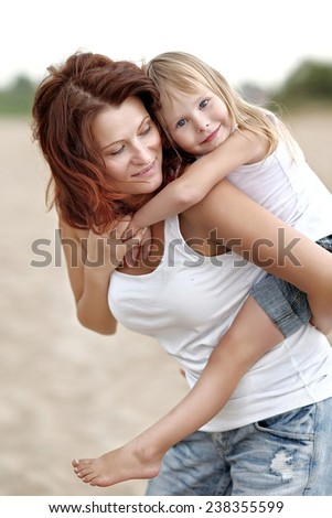 portrait of a happy family on summer nature - stock photo