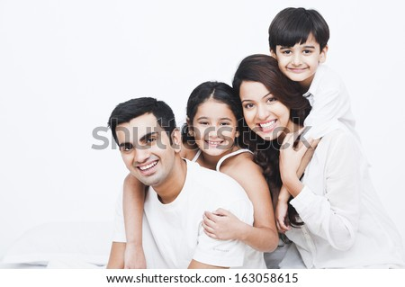 Portrait of a happy family on the bed