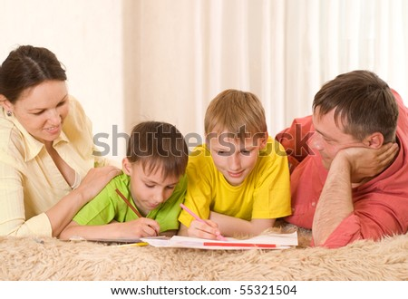 portrait of a happy family on the carpet - stock photo