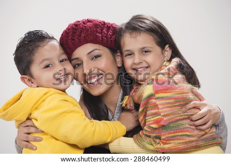 Portrait of a happy family over grey background - stock photo