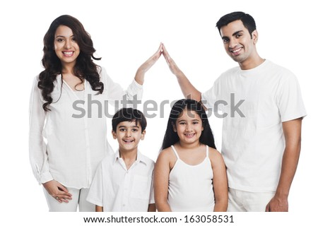 Portrait of a happy family smiling - stock photo