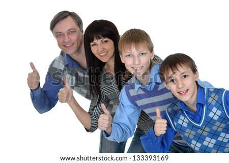 Portrait of a happy family smiling over white background
