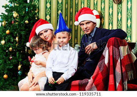 Portrait of a happy family spending Christmas time at home. - stock photo