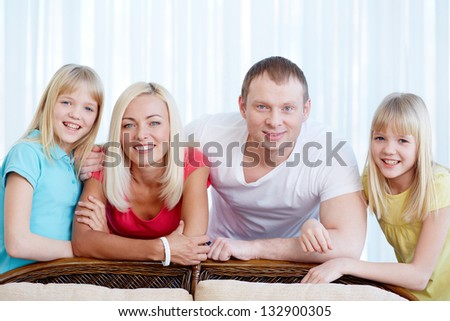 Portrait of a happy family wearing colorful casual - stock photo