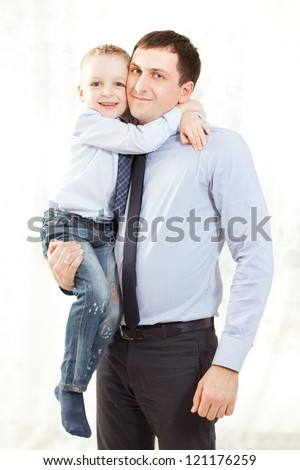 portrait of a happy father and son together - Indoor - stock photo