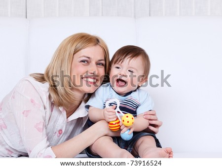 Portrait of a happy female and her toddler son laughing - stock photo
