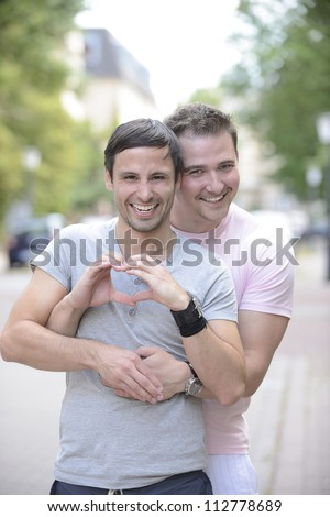 Portrait of a happy gay couple outdoors - stock photo