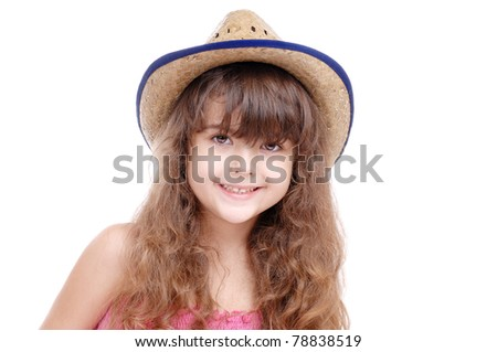 Portrait of a happy girl in a straw hat