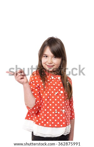 Portrait of a happy girl pointing  over white background - stock photo
