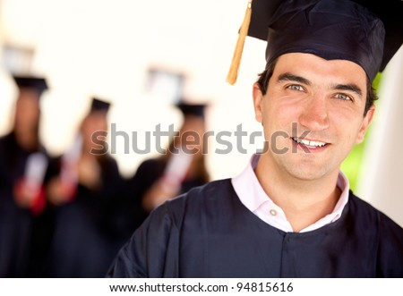 Portrait of a happy graduate male student - graduation concepts