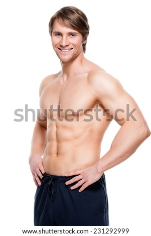 Portrait of a happy handsome man with muscular torso - isolated on white background. - stock photo