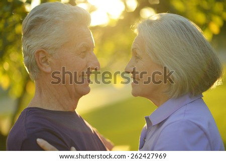 Portrait of a happy happy mature couple in autumn park