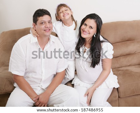 Portrait of a happy hispanic family - stock photo