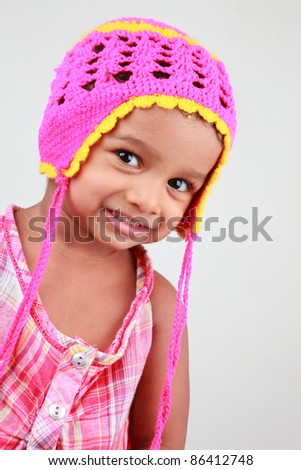 Portrait of a happy Indian baby girl - stock photo