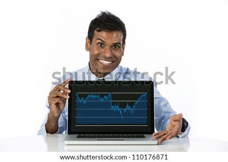 Portrait of a happy Indian business man showing his laptop to the viewer. - stock photo