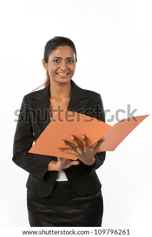 Portrait of a happy Indian business woman holding a folder. Isolated on a white background. - stock photo