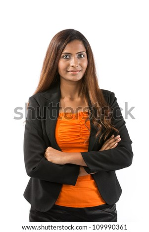 Portrait of a happy Indian business woman wearing orange top and dark business suit. - stock photo