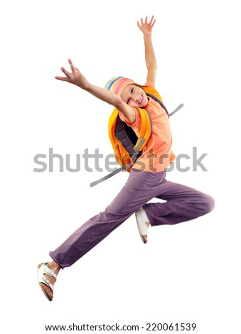Portrait of a happy jumping and dancing schoolgirl with backpack and headband. Isolated over white background - stock photo