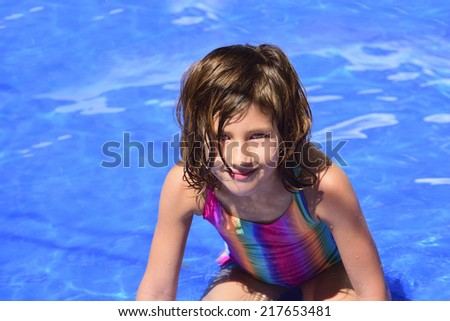 Portrait of a happy kid in the pool with copyspace - stock photo