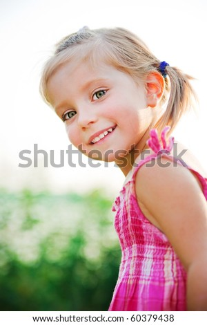 Portrait of a happy liitle girl - stock photo