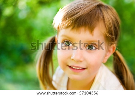 Portrait of a happy liitle girl close-up - stock photo
