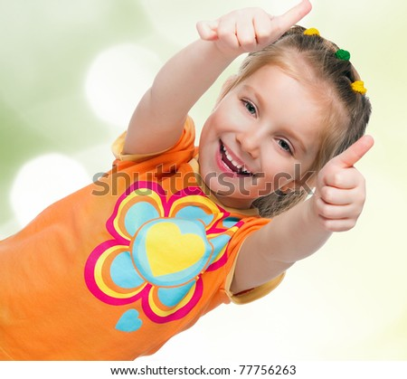 Portrait of a happy liitle girl over white - stock photo